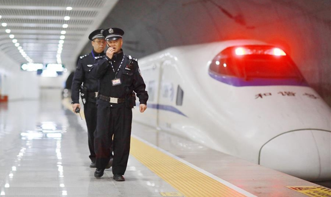 Police stick to posts during Spring Festival travel rush in railway station in China's Guizhou