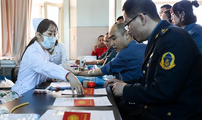 Volunteers donate blood for injured people of mine accident in China's Inner Mongolia