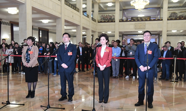 CPPCC members receive interview ahead of annual session