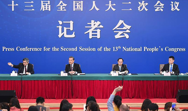 Chinese state councilor, FM meets press on foreign policy