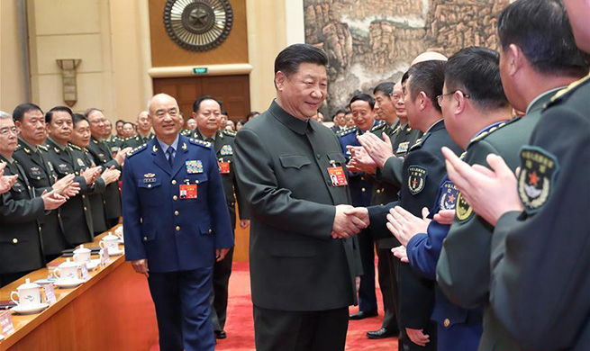 Xi attends plenary meeting of delegation of PLA, armed police