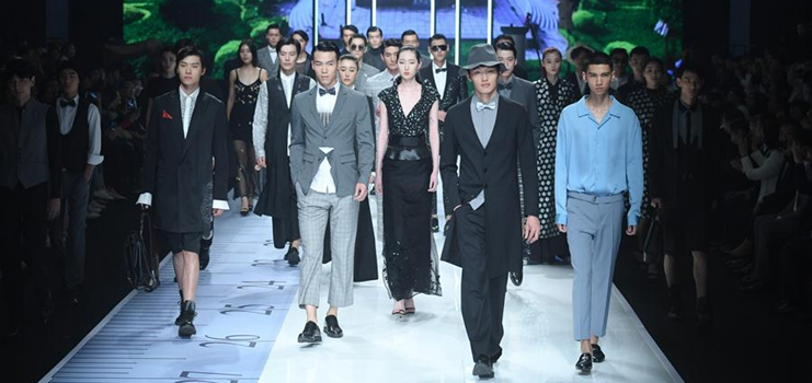 Models present creations during 2019 Shishi Fashion Week