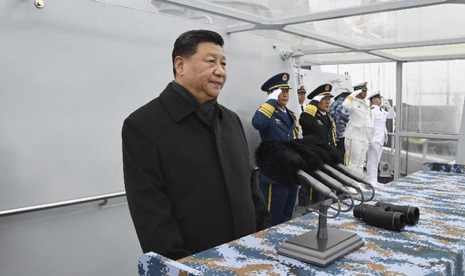 Xi reviews multinational fleet, championing maritime community with shared future