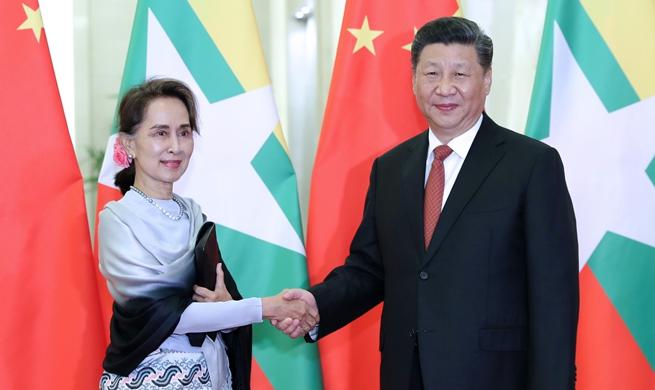 Xi meets Myanmar's State Counselor Aung San Suu Kyi