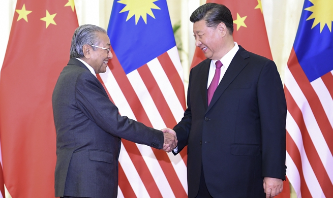 Xi meets Malaysian prime minister
