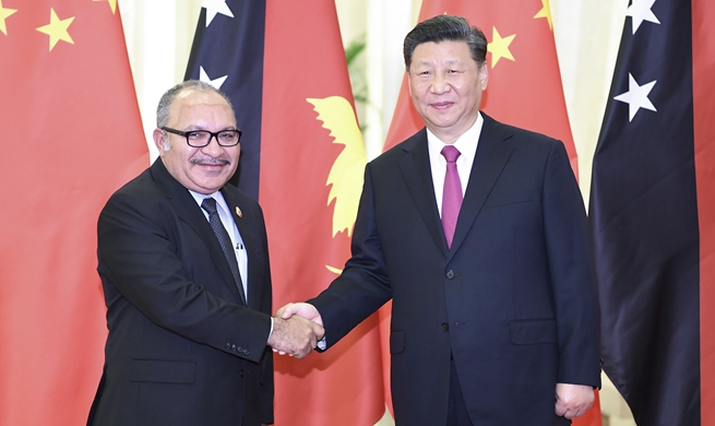 Xi meets Papua New Guinean prime minister