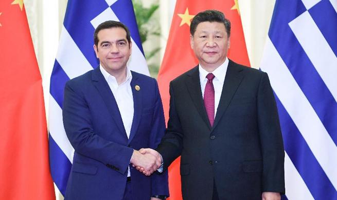 Xi meets Greek prime minister