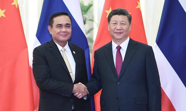 Xi meets Thai prime minister