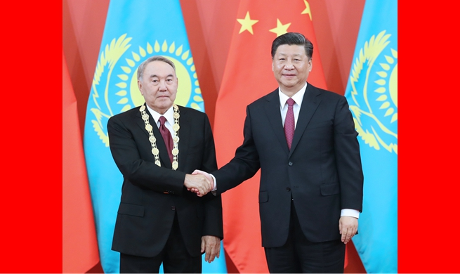 Xi meets first president of Kazakhstan