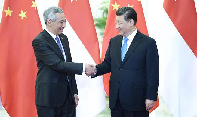 Xi meets Singaporean PM