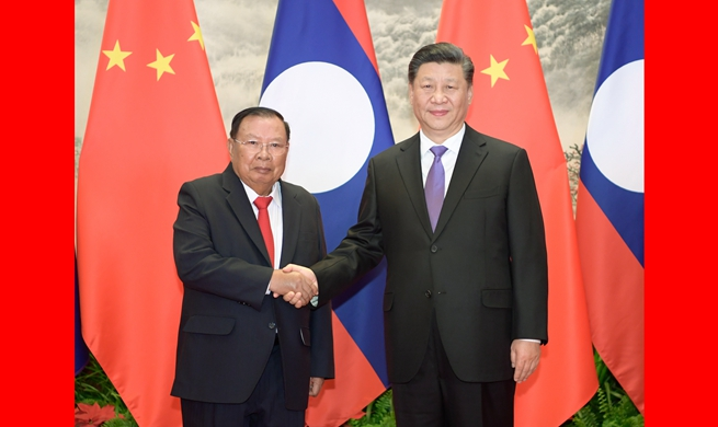 Xi holds talks with Lao president to promote ties