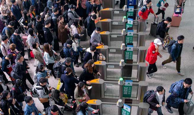In pics: May Day holiday travel rush in China's Jiangsu