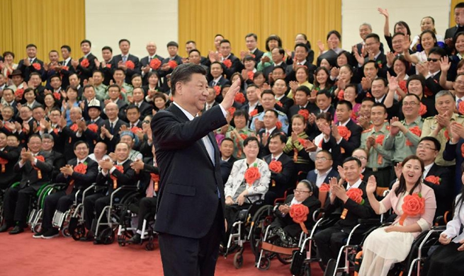 Xi meets role models with disabilities, their outstanding supporters