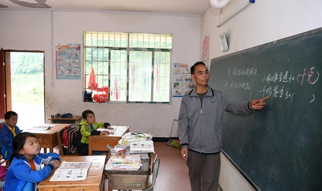 Pic story: rural teacher sticks to post for decades in S China's Guangxi