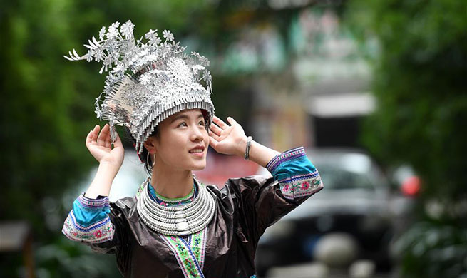 Women of Miao ethnic group wear fancy silver ornaments for decoration