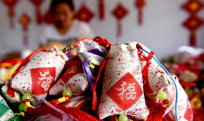 Workers make sachets for upcoming Chinese traditional Duanwu Festival in Shanxi