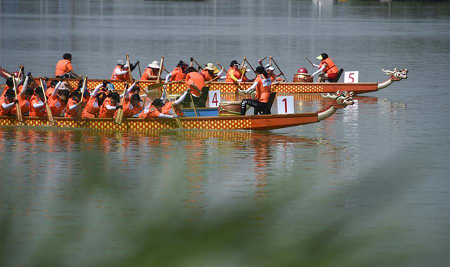 People participate in dragon boat competition in China's Ningxia