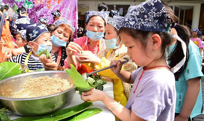 People make various kinds of Zongzi to celebrate upcoming Dragon Boat Festival