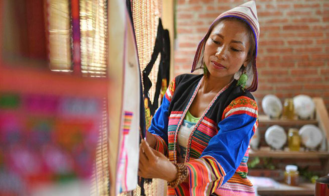 Villager of Jino ethnic group in China's Yunnan operates homestay tourism to increase income