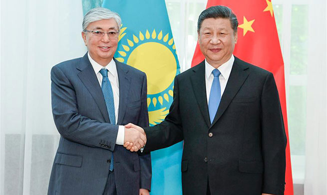 Chinese, Kazakh presidents pledge to enhance cooperation