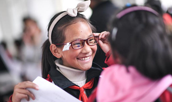 SW China county provides free glasses for students having eyesight problems