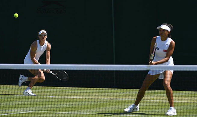 Zhang Shuai/Samantha Stosur into next round of women's doubles at Wimbledon