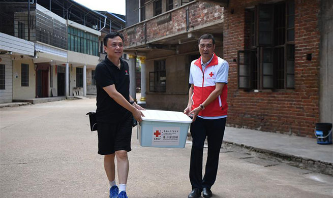 Disaster-relief packages distributed to flood victims in China's Hunan
