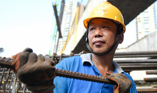 Constructors continue their work in hot summer in China's Zhejiang