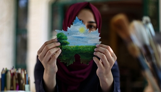 Feature: Gazan artist draws on grape leaves to overcome psychological stress