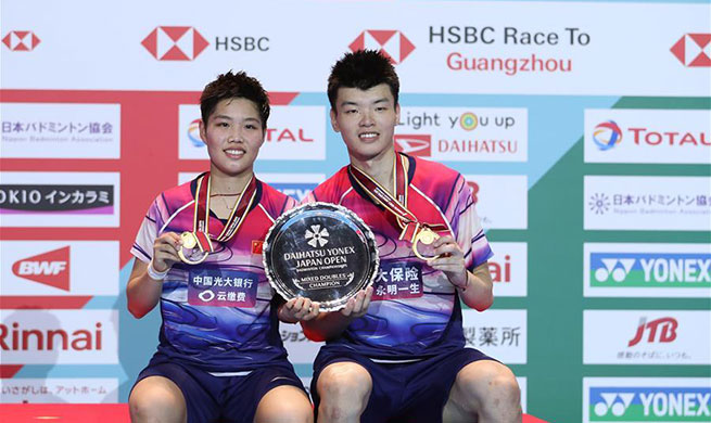 China wins mixed doubles at badminton's Japan Open