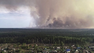 Russia declares state of emergency in four regions over wildfires
