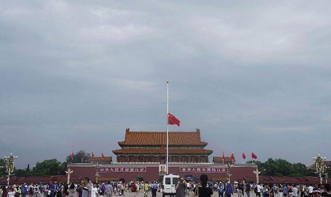 Chinese national flag flies at half-mast to mourn for late Chinese leader Li Peng at Tian'anmen Square