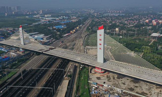 China's new architectural wonder: a 46,000-tonne bridge rotates successfully