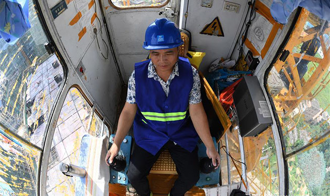 Tower crane operator works in Nanning, south China's Guangxi