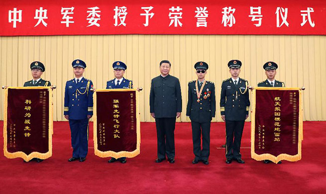 Xi signs orders to honor soldier, three military units