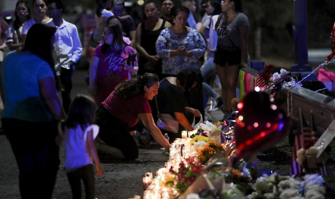 People take part in prayer and vigil for victims of shooting attack in El Paso, Texas