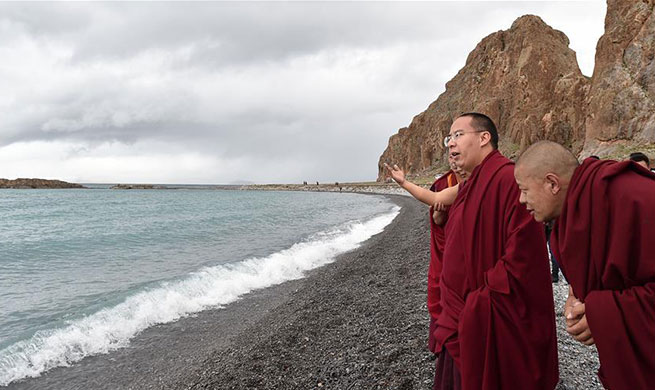 11th Panchen Lama worships on bank of Nam Co Lake in China's Tibet