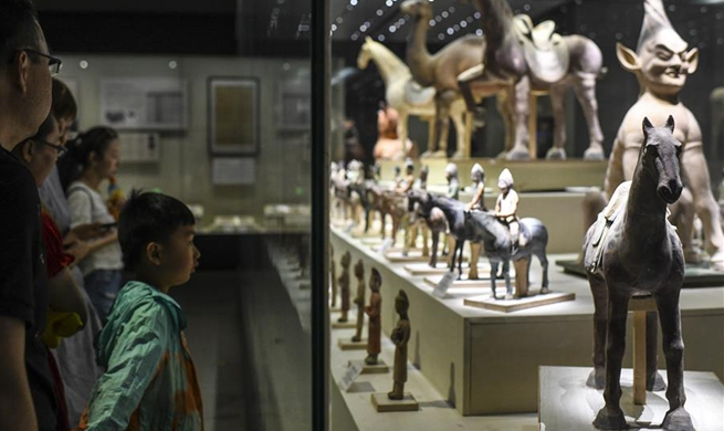Visitors view exhibits at Xinjiang Uygur Autonomous Region Museum