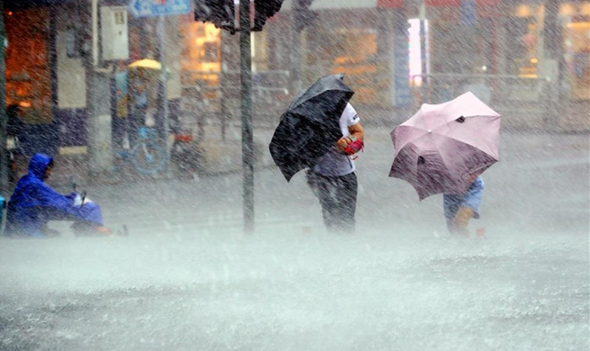 Shanghai issues orange alert as Typhoon Lekima lands