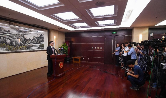 Central government spokesperson strongly condemns HK rioters' petrol bomb attacks on police