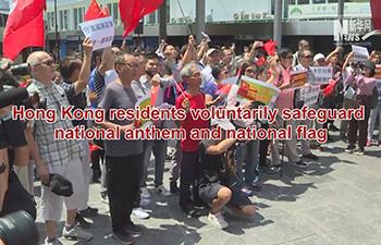 Hong Kong residents voluntarily safeguard national anthem and national flag
