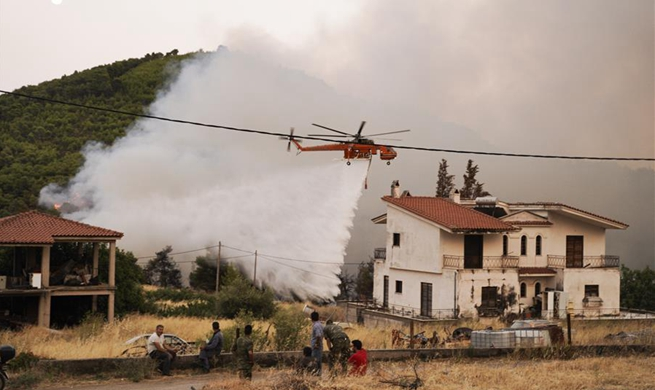 Greek fire fighters battling largest wildfires of this summer near Athens