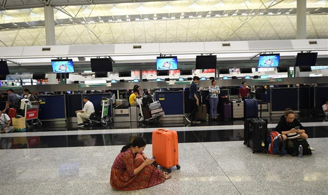 Hong Kong cancels most of outbound flights as protesters disrupt airport