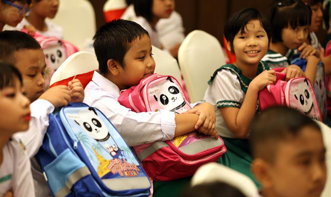 China donates school bags, stationeries to Myanmar students