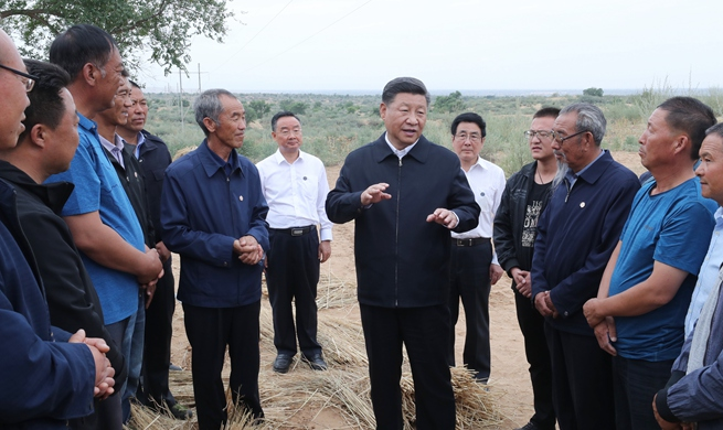 Xi highlights poverty relief, high-quality development, environmental protection