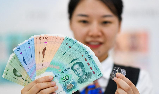 China issues new edition of renminbi bills, coins