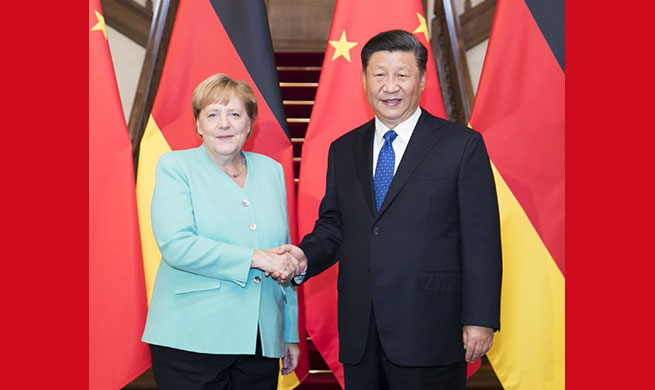 Xi meets German Chancellor Angela Merkel