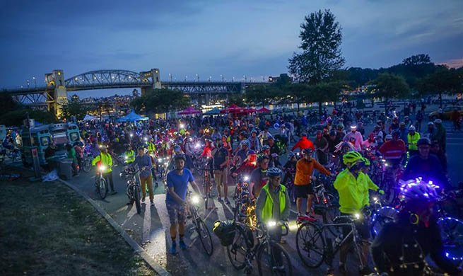 "People participate in ""Bike the Night"" event in Vancouver"