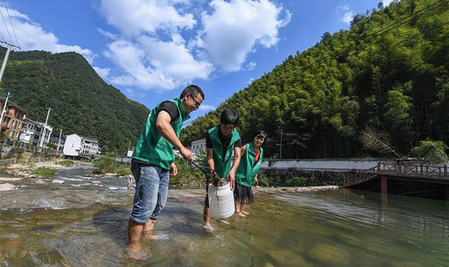 Volunteers help improve local environment in Gaohong town of east China's Zhejiang