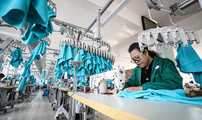 Xinhua Headlines: Bikinis, guitars and glasses...How China's small towns meet global demand